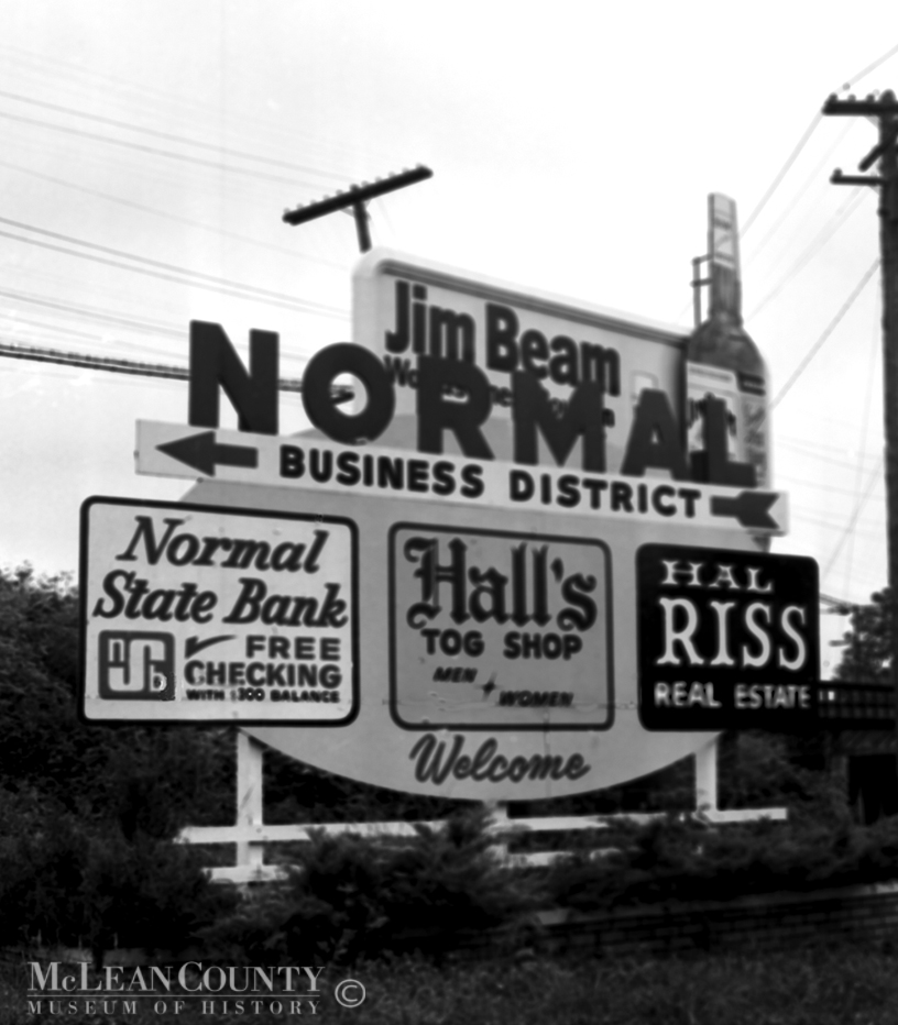 Welcome to Normal, Illinois.  Hall's Tog Shop, Normal State Bank, Realtor Hal Riss