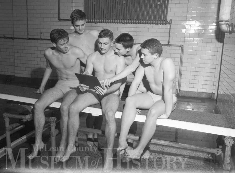 Five BHS swimmers prepare for the Big 12 Conference meet in Peoria in this mid-February 1953 scene. Left to right: Peter Whitmer, Hal Johnstone, Ray Baxter, Chuck Dunbar, and Adlai Rust, Jr.