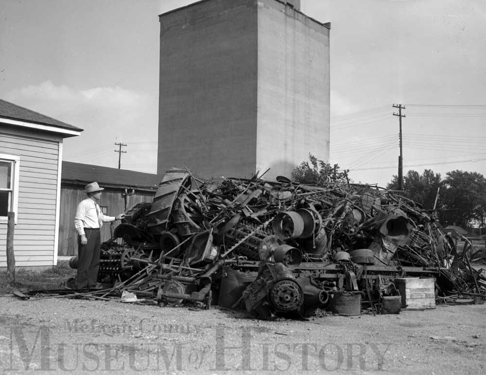 image of a pile of scrap outside an elevator in Colfax