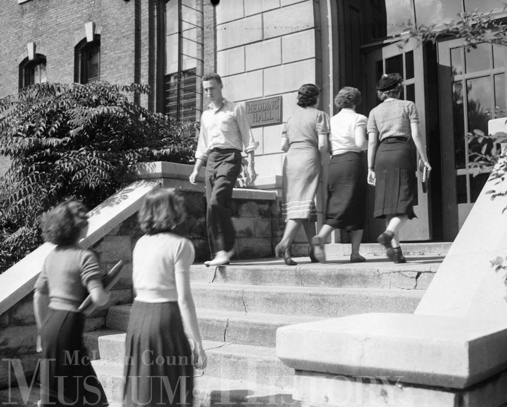 IWU students entering and leaving Hedding Hall, 1938.