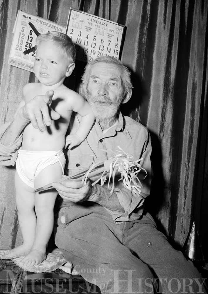 Photo of a father and his unhappy child, 1948