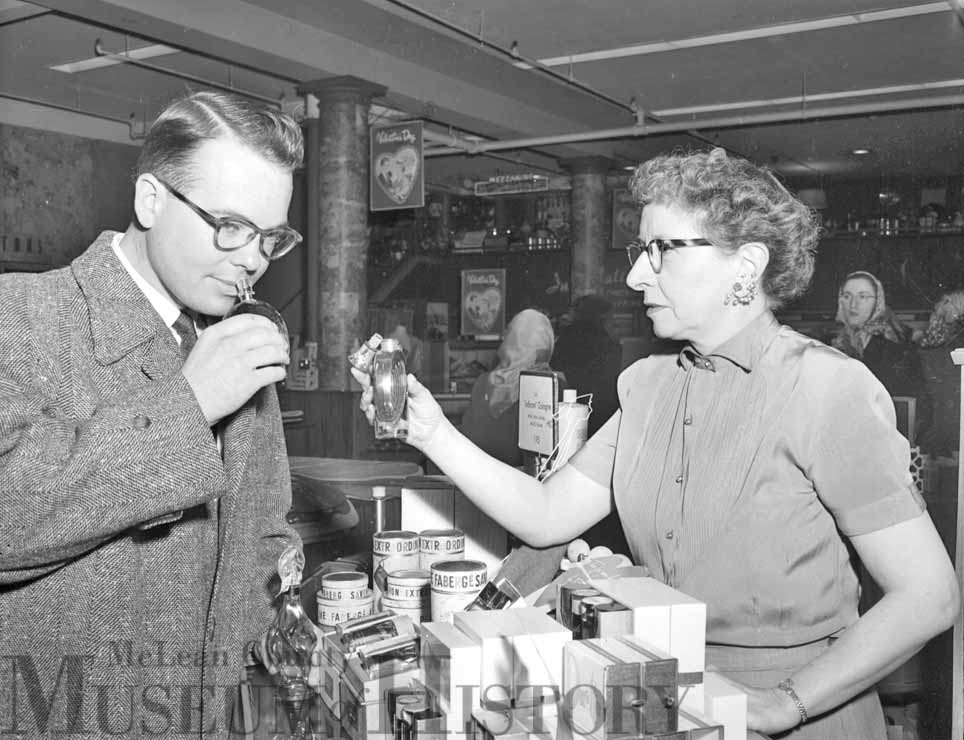 John Pratt, who in a few days time would marry Geraldine Dillon in a Valentine's Day ceremony, is seen here in a downtown Bloomington store sampling scents for his bride-to-be.