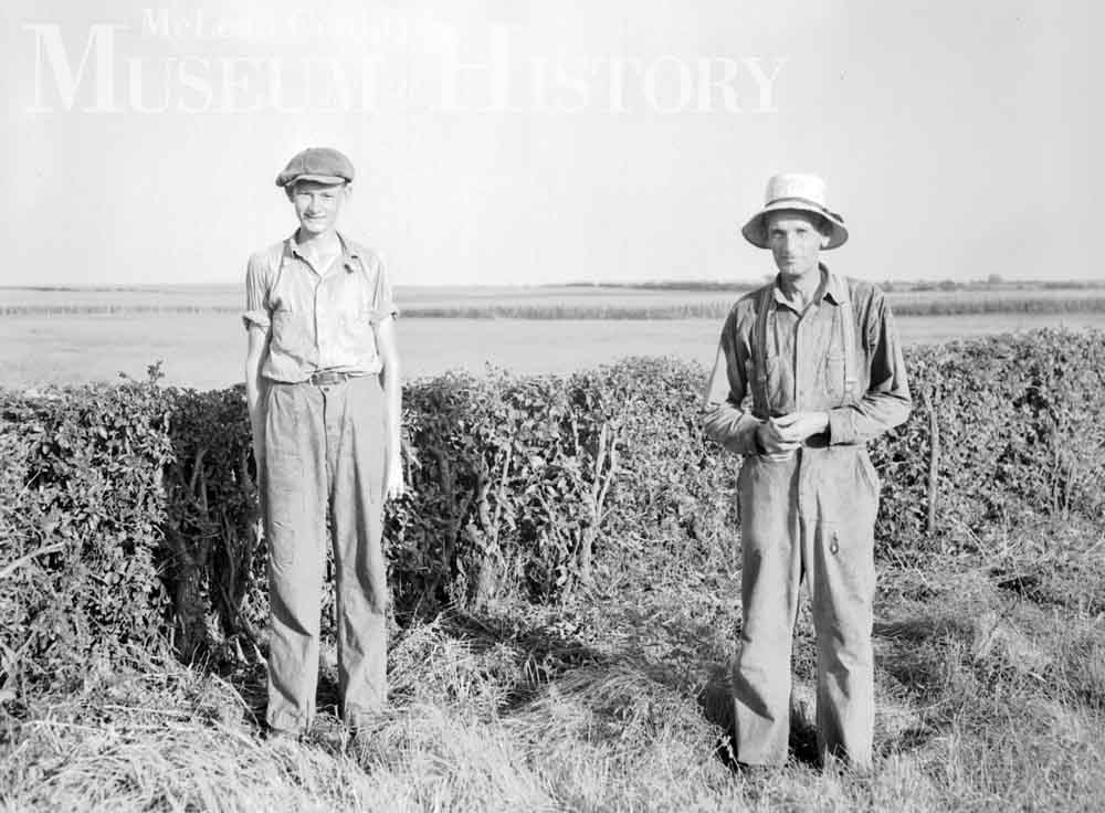 ​Farmer Joel Yordy and his son Willard, 1938.